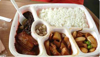 Chinese train meal on a disposable tray