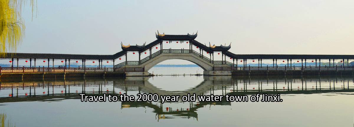 Travel to the 2000 year old water town of Jinxi.