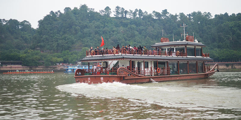 Take a boat ride on the river to see the Buddha