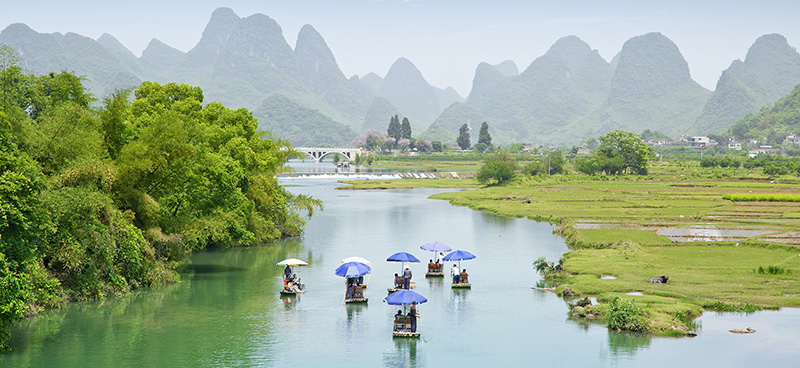 relaxing bamboo rafting on yulong river