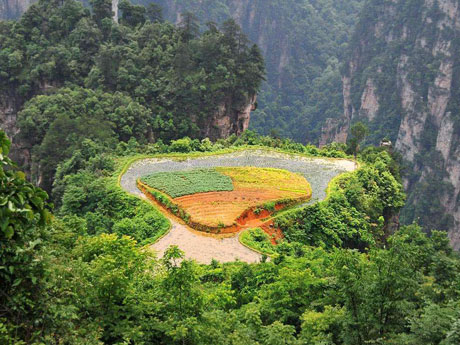 How did the local people change a mountaintop into a farmland?
