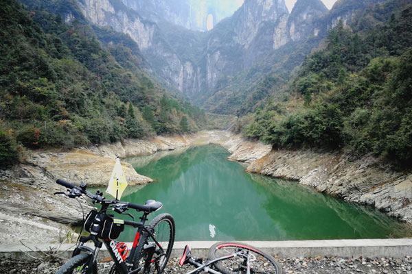 enjoy reflection of Tianmen Cave