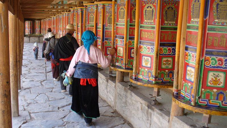 The long corridor of prayer wheels at Labrang Monastery